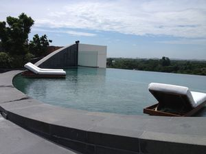 Rooftop pool with inset loungers