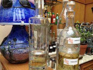 Digestifs on the bar, next to a mushroom-shaped glass lamp