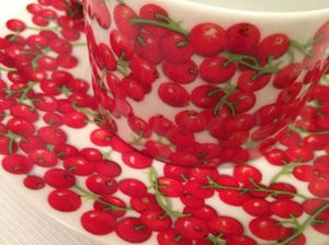 Redcurrants on breakfast's cups and saucers