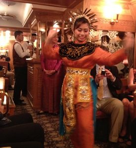 A local dancer onboard for the final leg