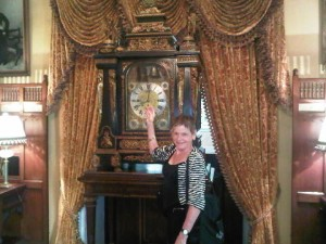 Luxury travel journalist MAry Gostelow and one of Falaknuma Palace's antique clocks