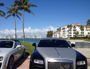 Bentley and Rolls, Fisher Island residences to right, Miami downtown in distance