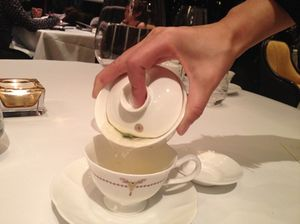 Tea poured into a - ladies' - cup