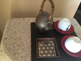 In-room teasets sit atop four-foot high stone blocks