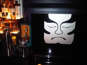A kabuki mask on the bar's closed box says 'bar closed'