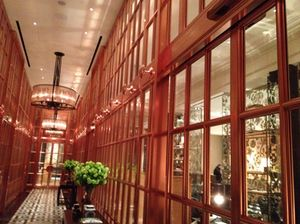 Enter the main lobby via an outer lobby of rose-hued bronze