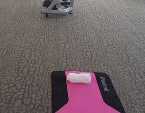 The pink yoga mat in the gym