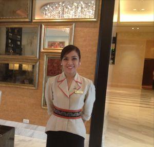 Chic uniform, stylish wall of mirrors