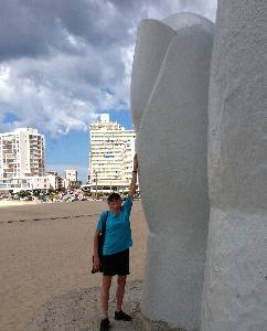 Luxury travel writer Mary Gostelow and la mano sculpute in a punta del este beach