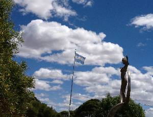 Sculpture and flag in Puerto Madryn