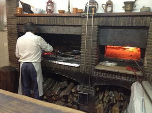 Traditional wood-burning pizza oven, in a centuries-old basement