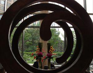 Look through a lobby sculpture...