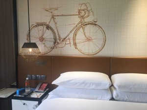 One of the four headboard-wall designs shows a bike