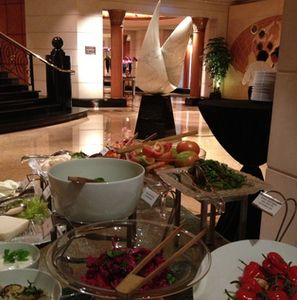 Food and art, with a massive lobby sculpture behind
