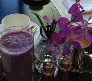 A breakfast smoothie matches the orchids