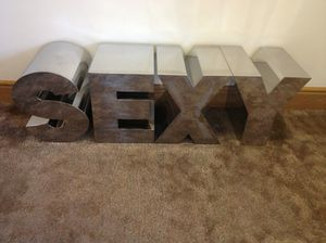 SEXY, on a carpet