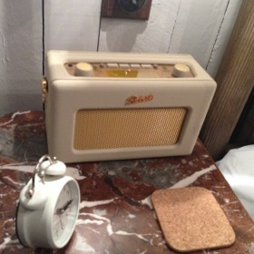 Old-fashioned alarm clock and Roberts radio