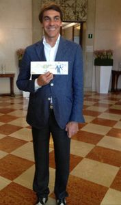 Giampaolo Ottazzi holds a card with his likeness