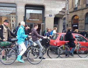 Cars get swamped by bikes…