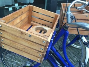 The hotel's blue bikes have wood baskets, with slots for your drink