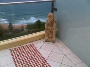 Anthropomorphic figure at the balcony of one of the suites of Jonahs Whale Beach in Australia