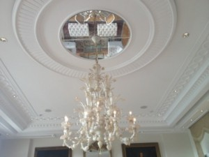 A typically elegant chandelier in a magnificently-refined lobby