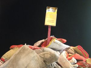 Pop-up sculpture of construction workers' gloves