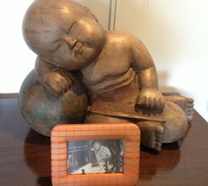 Sleeping Buddha - a photo of Jim Thompson in front
