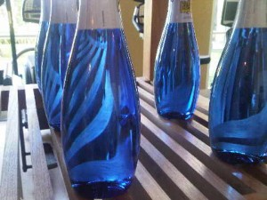 Blue bottles at the luxury Finca Cortesin's Beach Club