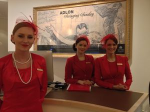 Kempinski's signature Ladies in Red, with veiled hats