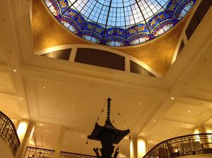 Looking up, past the central sculpture, at the lobby's dome