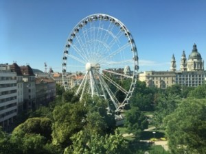 View from suite 714, a fairground wheel, with St Stephen's to the right