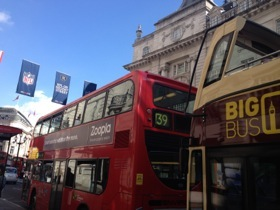 Buses right outside Café Royal Hotel London, on Regent Street