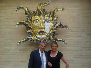 Park Hyatt Milano's Claudio Ceccherelli in front of the hotel lobby lounge's stunning Testa di Medusa head