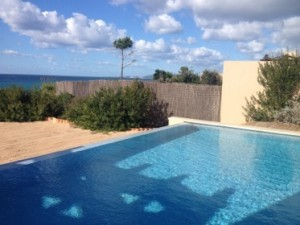 Looking across 1317's pool and private beach
