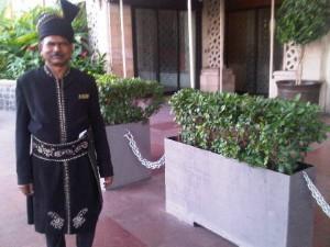 Doorman at Taj Mahal Palace luxury hotel in Mumbai, India