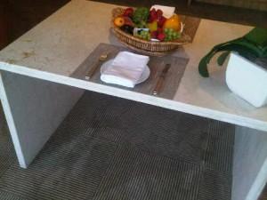 room table by Arthur Matos Casas at the Emiliano luxury hotel in Sao Paulo