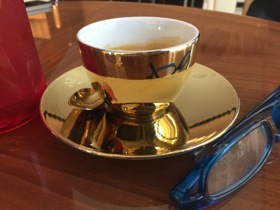 The epitomal golden coffee cup