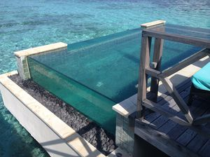 Glass-sided cantilevered pool of an overwater villa