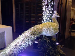 A floral peacock (lifesize)
