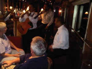 Musicians play at Orient Express' Hiram Bingham luxury train in Peru