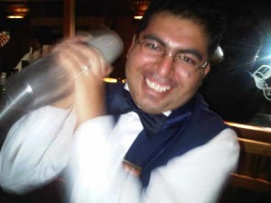 Barman prepare Pisco Sour at Orient Express' Hiram Bingham luxury train in Peru