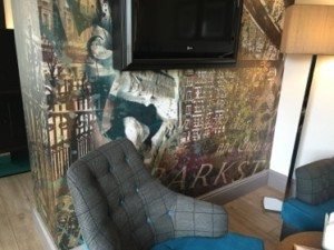 Some bedroom walls feature collages of local scenes