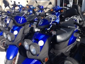 Blue scooters a-ready