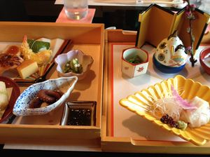 A two-tier bento box, opened up (note the standing fan)