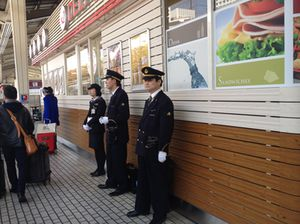 Guards, in white gloves, await the train …