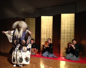 A Noh dancer, and back-up musician
