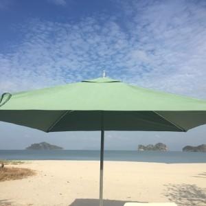 A green umbrella, and the Andaman Sea