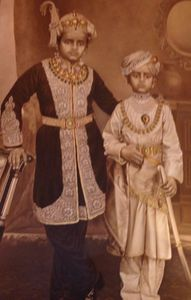 Two little boys, in typical Royal Mysore gear