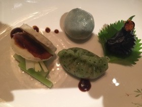 From left, clockwise: crispy duck, crab and spinach, squid ink and fish roe, steamed vegetable dumpling